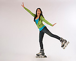 Young lady posed in rollerblades on a white background.