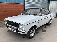 BNPS.co.uk (01202 558833)<br /> Pic: HampsonAuctions/BNPS<br /> <br /> Pictured: 1979 Ford Escort 1.6 Ghia.<br /> <br /> Since the 1990s, Geoff Barlow, 46, has collected dozens of classic cars from an Escort Mexico replica to several types of Transit, Cortina, and Sierra.<br /> <br /> However, he still regrets selling the first car which inspired his passion, a 1980 Escort Mark 2 he bought from his sister in 1992.  <br /> <br /> Geoff's fascination with Fords gathered pace in the last decade and he 'lost control,' buying as many Fords as he came across and saving them from disrepair.