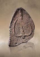 Late European Neolithic prehistoric Menhir standing stone with carvings on its face side. The representation of a stylalised male figure starts at the top with a long nose from which 2 eyebrows arch around the top of the stone. below this is a carving of a falling figure with head at the bottom and 2 curved arms encircling a body above.Excavated from Nuraghe Orrubiu IV, Laconi. Menhir Museum, Museo della Statuaria Prehistorica in Sardegna, Museum of Prehoistoric Sardinian Statues, Palazzo Aymerich, Laconi, Sardinia, Italy