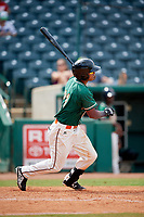Greensboro Grasshoppers left fielder Jhonny Santos (21) follows through on a swing during a game against the Lakewood BlueClaws on June 10, 2018 at First National Bank Field in Greensboro, North Carolina.  Lakewood defeated Greensboro 2-0.  (Mike Janes/Four Seam Images)