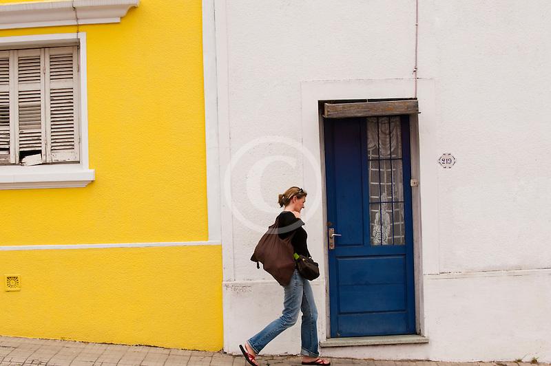 Uruguay, Colonia del Sacramento, Woman walking on sidewalk Historic District