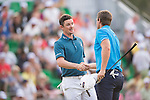 Justin Rose of England and Lucas Bjerregaard of Denmark congratulate each other on their tie during Hong Kong Open golf tournament at the Fanling golf course on 24 October 2015 in Hong Kong, China. Photo by Aitor Alcade / Power Sport Images