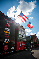 Oct 4, 2020; Madison, Illinois, USA; American flag atop the car hauler of NHRA top fuel driver Doug Kalitta during the Midwest Nationals at World Wide Technology Raceway. Mandatory Credit: Mark J. Rebilas-USA TODAY Sports