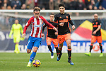 Antoine Griezmann of Atletico de Madrid (left) competes for the ball with Carlos Soler of Valencia CF during the match Atletico de Madrid vs Valencia CF, a La Liga match at the Estadio Vicente Calderon on 05 March 2017 in Madrid, Spain. Photo by Diego Gonzalez Souto / Power Sport Images