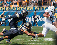 Pitt defensive back Ryan Lewis tackles Penn State running back Saquon Barkley. The Pitt Panthers defeated the Penn State Nittany Lions 42-39 at Heinz Field, Pittsburgh, Pennsylvania on September 10, 2016.