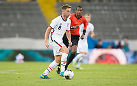 GUADALAJARA, MEXICO - MARCH 24: Djordje Mihailovic #8 of the United States looks for an open man during a game between Mexico and USMNT U-23 at Estadio Jalisco on March 24, 2021 in Guadalajara, Mexico.
