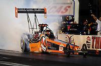 Oct. 31, 2008; Las Vegas, NV, USA: NHRA top fuel dragster driver Urs Erbacher does a burnout during qualifying for the Las Vegas Nationals at The Strip in Las Vegas. Mandatory Credit: Mark J. Rebilas-
