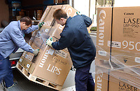 Workers move boxes containong Canon office equipment in Tokyo banking centre called Otemachi..Mar 2002.