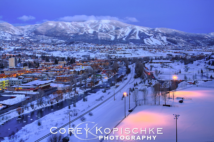 The lights of Howelsen hill and downtown Steamboat Springs, Colorado at dusk.