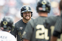 Vanderbilt Commodores outfielder Stephen Scott (19) crosses the plate after hitting a home run during the second inning of Game 8 of the NCAA College World Series against the Mississippi State Bulldogs on June 19, 2019 at TD Ameritrade Park in Omaha, Nebraska. Vanderbilt defeated Mississippi State 6-3. (Andrew Woolley/Four Seam Images)