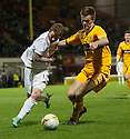 Don's Jonny Hayes and Motherwell's Fraser Kerr challenge for the ball .