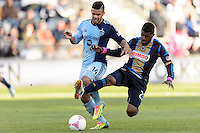 Sheanon Williams (25) of the Philadelphia Union goes in for a tackle on Dom Dwyer (14) of Sporting Kansas City. Sporting Kansas City defeated the Philadelphia Union 2-1 during a Major League Soccer (MLS) match at PPL Park in Chester, PA, on October 26, 2013.