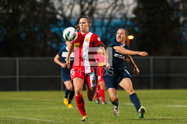 Western New York Flash defender Katherine Reynolds (16) is marked by Sky Blue FC forward Lisa De Vanna (11). Sky Blue FC defeated the Western New York Flash 1-0 during a National Women's Soccer League (NWSL) match at Yurcak Field in Piscataway, NJ, on April 14, 2013.