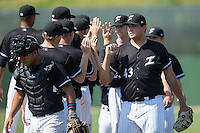 Kannapolis Intimidators relief pitcher Taylore Cherry (43) high fives teammates after closing out the win over the Lakewood BlueClaws at Kannapolis Intimidators Stadium on May 8, 2016 in Kannapolis, North Carolina.  The Intimidators defeated the BlueClaws 3-2.  (Brian Westerholt/Four Seam Images)