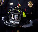 Hartford Firefighter Ronald Talit, holds the helmet of his fallen comrade, during the funeral for Hartford firefighter Kevin Bell, Monday, Oct 13, 2014, at the First Cathedral, in Bloomfield, Bell was killed in a house fire last week in Hartford. (AP Photo / Journal Inquirer, Jim Michaud)
