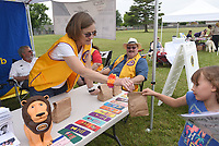 SUMMER READING CELEBRATION<br />Jeanne Hasbrouck (cq) with the Pea Ridge Lions Club hands out book marks and treats on Saturday June 5 2021 during the Pea Ridge Communith Library summer reading kickoff celebration at Pea Ridge City Park. The event starts the library's summer reading program that encourages children to read throughout the summer. The more kids read, the more prizes they receive, said Ashdon (cq) Wilson, library program director. Library patrons may enroll children in the program at the library, 801 N. Curtis Ave. in Pea Ridge. The event featured booths and information from Pea Ridge area clubs and businesses. Go to nwaonline.com/210606Daily/ to see more photos.<br />(NWA Democrat-Gazette/Flip Putthoff)