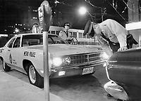 1970 File - <br /> <br /> Downtown night beat: Patrol Sgt. Eric Hudson (left) and Constable Ronald McCall of Metro police 52 division; check a hitrun case in the heart of the city. General policy is to man each of the force's 430 patrol cars with one man. But in areas where crime rate and population density are high an extra man is added. Officers interviewed by The Star thought two-man patrols would cut down attacks.<br /> <br /> Photo : Boris Spremo - Toronto Star archives - AQP