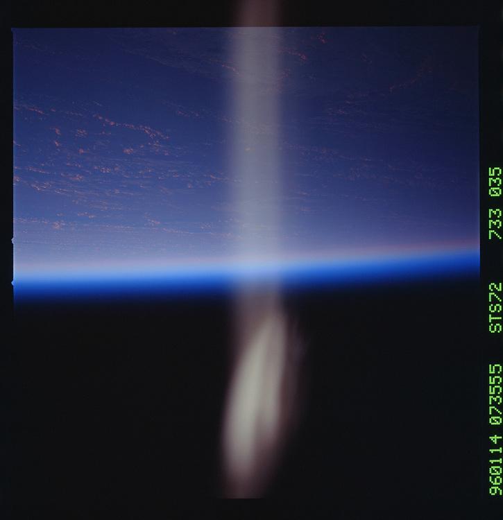 John Angerson. STS-72 Book.<br /> Public Domain Image.<br /> NASA images Courtesy National Archives - Record Group number: 255-STS-STS072<br /> <br /> Description: Earth observations taken from shuttle orbiter Endeavour during STS-72 mission.<br /> <br /> Subject Terms: STS-72, ENDEAVOUR (ORBITER), EARTH OBSERVATIONS (FROM SPACE)<br /> <br /> Date Taken: 1/14/1996<br /> <br /> Categories: Earth Observations<br /> <br /> Interior_Exterior: Exterior<br /> <br /> Ground_Orbit: On-orbit<br /> <br /> Original: Film - 70MM CT<br /> <br /> Preservation File Format: TIFF<br /> <br /> geon: PACIFIC OCEAN<br /> <br /> feat: PAN-CLOUDS, REFLECTION<br /> <br /> tilt: High Oblique<br /> <br /> cldp: 50<br /> <br /> nlat: -18.5<br /> <br /> nlon: 167.9<br /> <br /> azi: 247<br /> <br /> alt: 164<br /> <br /> elev: -2