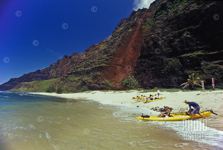 Kayak paddling to explore Milolii Beach on Kauai's Na Pali Coast