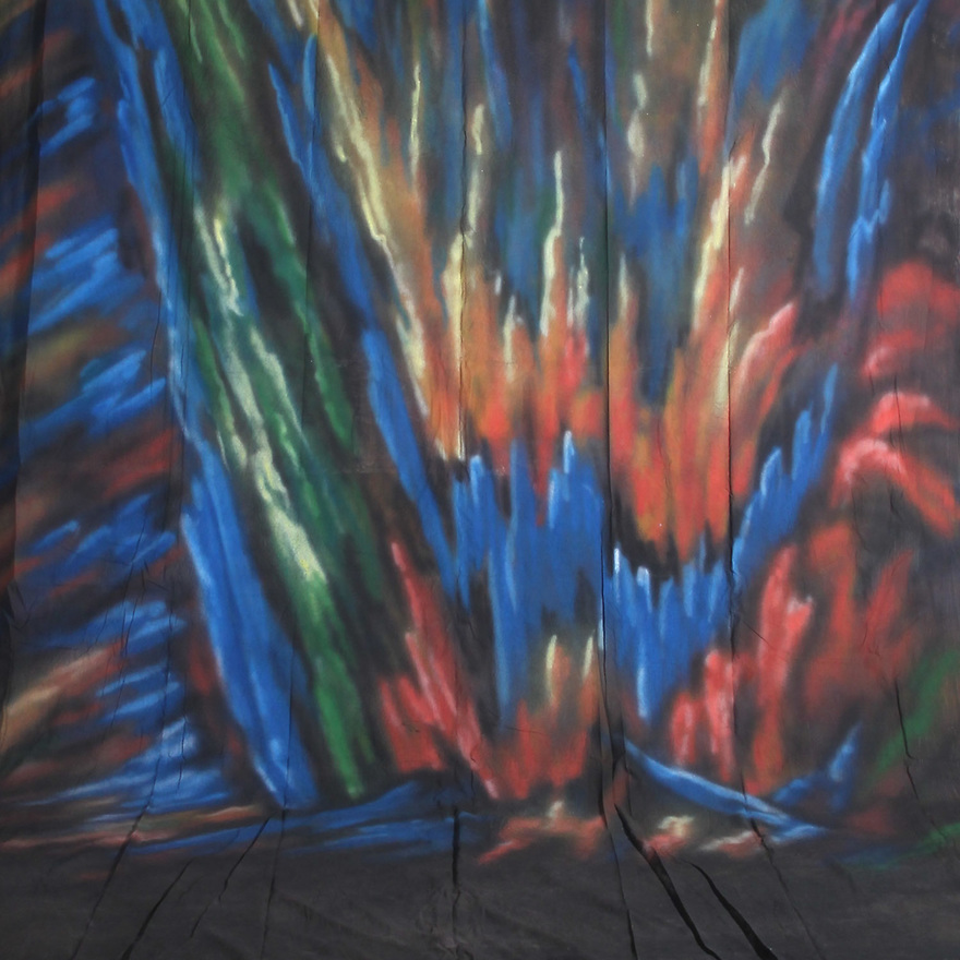 Backdrop featuring a colorful neon abstract pattern in bright orange, yellow and green on blue and black field