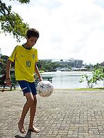 Kids play football near Arena Fonte Nova