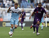 Football, Serie A: S.S. Lazio - Fiorentina, Olympic stadium, Rome, 7 october 2018. <br /> Lazio's Ciro Immobile (l) in action with Fiorentina's Santos Da Silva Gerson (r) during the Italian Serie A football match between S.S. Lazio and Fiorentina at Rome's Olympic stadium, Rome on October 7, 2018.<br /> UPDATE IMAGES PRESS/Isabella Bonotto