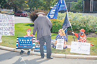 Wearing a three-corner hat, organizer John Hugo speaks with attendees as the alt-right organization Super Happy Fun America demonstrates against facemasks, vaccines, and pandemic closures, and in support of the reelection of President Donald J. Trump near the residence of Massachusetts governor Charlie Baker in Swampscott, Massachusetts, on Sat., Sept. 26, 2020. Super Happy Fun America is most well known for organizing the Straight Pride Parade in Boston on August 31, 2019.