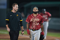 Canaan Smith-Njigba (24) of the Altoona Curve walks off the field with trainer Tyler Brooks after injuring himself running out a ground ball during the game against the Somerset Patriots at TD Bank Ballpark on July 24, 2021, in Somerset NJ. (Brian Westerholt/Four Seam Images)