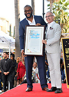 LOS ANGELES, CA. October 01, 2019: Tyler Perry & Mitch O'Farrell at the Hollywood Walk of Fame Star Ceremony honoring Tyler Perry.<br /> Pictures: Paul Smith/Featureflash