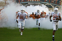 01 APRIL 2006: University of Texas defensive tackle Tully Janszen, left, runs onto the field with his teammates at Darrell K. Royal Memorial Stadium before the Longhorns annual spring Orange vs White Scrimmage.