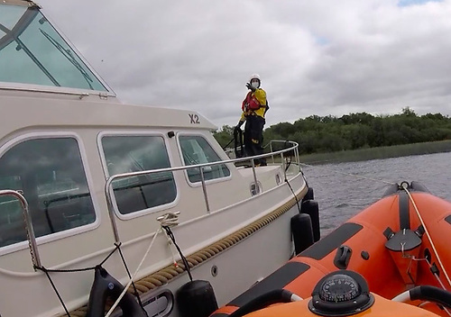 Lough Derg RNLI sets up an alongside tow for the 35ft cruiser on Friday evening 11 June