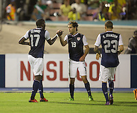 Kingston, Jamaica - Friday, June 7, 2013: USMNT 2-1 over Jamaica  during World Cup qualifying at the National Stadium. Jozy Altidore scores on Donovan Ricketts and is congratulated by Graham Zusi.