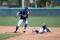 Los Angeles Dodgers shortstop Eddys Leonard (84) covers second base on a stolen base attempt as Esteury Ruiz (3) slides into second base during an Instructional League game against the San Diego Padres at Camelback Ranch on September 25, 2018 in Glendale, Arizona. (Zachary Lucy/Four Seam Images)