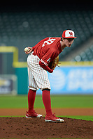Houston Cougars relief pitcher Griffin Hattingh (42) looks to his catcher for the sign against the Vanderbilt Commodores during game nine of the 2018 Shriners Hospitals for Children College Classic at Minute Maid Park on March 3, 2018 in Houston, Texas. The Commodores defeated the Cougars 9-4. (Brian Westerholt/Four Seam Images)