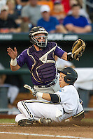 TCU Horned Frogs catcher Evan Skoug (9) blocks the plate as Vanderbilt Commodores baserunner Jeren Kendall (3) scores in Game 12 of the NCAA College World Series on June 19, 2015 at TD Ameritrade Park in Omaha, Nebraska. The Commodores defeated TCU 7-1. (Andrew Woolley/Four Seam Images)