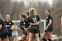 LOUISVILLE, KY - MARCH 13: Emina Ekic #13 and Katie McClure #22 of Racing Louisville FC hug to celebrate a goal during a game between West Virginia University and Racing Louisville FC at Thurman Hutchins Park on March 13, 2021 in Louisville, Kentucky.