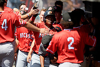 Batavia Muckdogs Albert Guaimaro (13) high fives teammates after hitting a home run during a NY-Penn League game against the West Virginia Black Bears on August 29, 2019 at Monongalia County Ballpark in Morgantown, New York.  West Virginia defeated Batavia 5-4 in ten innings.  (Mike Janes/Four Seam Images)