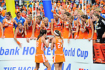 The Hague, Netherlands, June 14: Naomi van As #18 of The Netherlands drinks champagne out of the World Cup Trophy after the field hockey gold medal match (Women) between Australia and The Netherlands on June 14, 2014 during the World Cup 2014 at Kyocera Stadium in The Hague, Netherlands. Final score 2-0 (2-0)  (Photo by Dirk Markgraf / www.265-images.com) *** Local caption ***