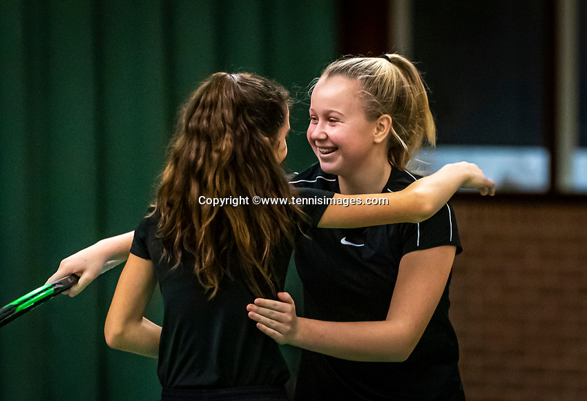 Wateringen, The Netherlands, December 15,  2019, De Rhijenhof , NOJK juniors doubles , Final girls 12  years, Britt du Pree (NED) and Lina Ilahi (NED)  (L) winners celebrate matchpoint,<br /> Photo: www.tennisimages.com/Henk Koster