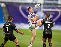 22nd August 2020; The John Smiths Stadium, Huddersfield, Yorkshire, England; Rugby League Coral Challenge Cup, Catalan Dragons versus Wakefield Trinity; Jack Croft of Wakefield Trinity catches the kick forward under pressure from Josh Drinkwater and David Mead of Catalan Dragons