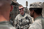 SOUTHERN IRAQ 18 AUGUST 2010: Second Lieutenant Duke of B/223 Company, Tomahawk Battalion of the 4/2 Strykers Brigades  smiles with his comrades  en-route to the Kuwait border where he will be packing up and heading back to the USA.  Iraq is preparing after US President Barack Obama has confirmed the end of all combat operations in the country by 31 August..Some 50,000 of 65,000 US troops currently in Iraq are set to remain until the end of 2011 to advise Iraqi forces and protect US interests.The remaining 50,000 troops will stay in the country in order to train Iraqi security forces, conduct counterterrorism operations and provide civilians with ongoing security, said Mr Obama..An agreement negotiated with the Iraqis in 2008 states that these troops must be gone from the country by the end of next year. pic Graham Crouch/The Guardian