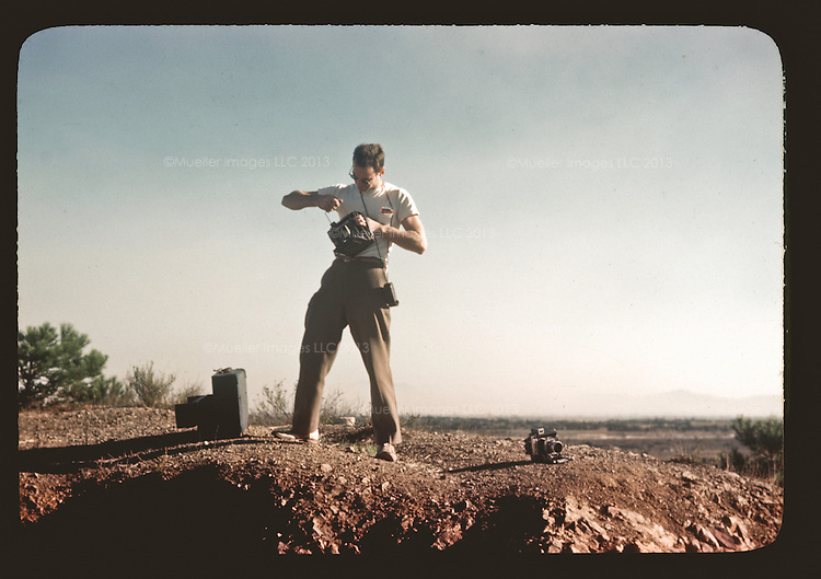 """After he finished school in LA and before he settled down in the Black Hills of South Dakota, Don Mueller went into the desert. He and his pal Don McKenzie had their camera gear, a jeep, supplies and sunglasses. The excursion into the sandstone arches of Utah and the cacti smattered deserts of Arizona, was known only as, """"ex-pe-di-teeon Moab."""" After a brief stint in landscape and tourism photography, and many days spent in the hot desert sun, the young men called it quits and moved on to greener pastures."""