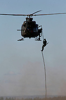 Special forces being inserted with Bell 412 helicopter during an air show at Rygge Air Station.