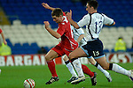 International Friendly match between Wales and Scotland at the new Cardiff City Stadium : Wales' Sam Vokes is chased by Scotlands' Lee Wallace.