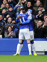 Pictured: Romelu Lukaku of Everton (R) celebrating his goal with team mate Kevin Mirallas (L). Saturday 22 March 2014<br /> Re: Barclay's Premier League, Everton v Swansea City FC at Goodison Park, Liverpool, UK.