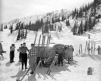 Loading snowmobile for skiing,Sunshine Village, Banff National Park. <br /> <br /> PHOTO :  Alberta Public Affairs Bureau,