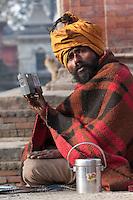 Pashupatinath, Nepal.  Sadhu (Holy Man) and his Radio at Nepal's Holiest Hindu Temple.