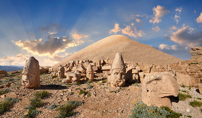Statue head at sunset of from left, Zeus, Commagene, Apollo, Herekles & Eagle in front of the 62 BC Royal Tomb of King Antiochus I Theos of Commagene, west Terrace, Mount Nemrut or Nemrud Dagi summit, near Adıyaman, Turkey