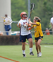 The University of Virginia women's lacrosse player Lauren Benner tangles with Townson's Jackie LaMonica during the first game since the tragic death of Virginia player Yeardley Love Sunday May 16, 2010 at Klockner Stadium in Charlottesville, Va. The Cavaliers rallied in the last four minutes to beat Towson 14-12 and reach the quarter finals of the NCAA tournament. Love's body was found May 3, and Virginia men's lacrosse player George Huguely is charged with murder. Photo/Andrew Shurtleff..