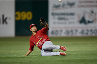 Palm Beach Cardinals left fielder Chase Pinder (5) slides to make a catch during a game against the Florida Fire Frogs on May 1, 2018 at Osceola County Stadium in Kissimmee, Florida.  Florida defeated Palm Beach 3-2.  (Mike Janes/Four Seam Images)